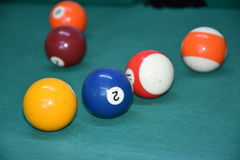 Billiard balls on the green table isolated Royalty Free Stock Image