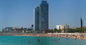 Beaches and architecture of Barcelona city.Time lapse.  Zoom out. stock video footage