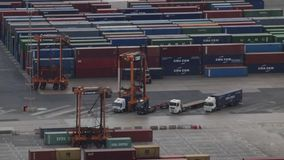 Activity in the container terminal.Time Lapse. Maneuvers loading and unloading of several trucks at the container terminal at the port of Barcelona.Time Lapse stock footage