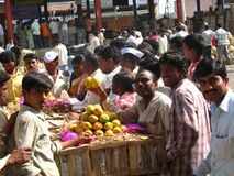 Activity in the fruit market during mango season royalty free stock photo