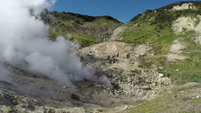 Activity of natural volcanic hot springs emission clouds of hot gas and steam stock video footage