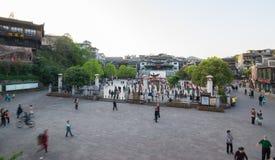 Activity performing around the phonenic ancient town. FENGHUANG - APRIL 13 : Activity performing around the phonenic, statue area in Fenghuang (Phoenix) ancient Stock Photos