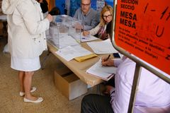 Activity at Polling station during elections day in Spain. Voting activity in a polling station during the general elections day in the Spanish island of stock photo