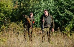 Activity for real men concept. Hunters gamekeepers looking for animal or bird. Hunting with friends. Hunters friends. Enjoy leisure. Hunters with rifles in royalty free stock images