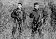 Activity for real men concept. Hunters gamekeepers looking for animal or bird. Illegal hunting. Hunters friends enjoy. Leisure. Hunters with rifles in nature stock photo