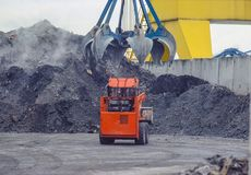Wheel-type loader under a grab head. stock images