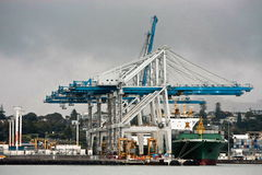 Activity at shipping container port. Activity at container shipping port, with ship being loaded Stock Photo