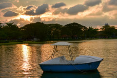 The activity of spinning boat in lake and evening Sun light Stock Image