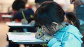 Activity of teaching kindergarten. Kindergarten students are learning stock video