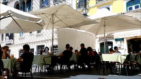 Daily activity on terrace restaurant in Lisbon stock video footage