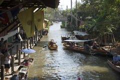 Activity on a Thai canal at Damnoen Saduak Thailand Royalty Free Stock Photo