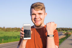 Activity tracker on a man`s wrist. On the street stock image