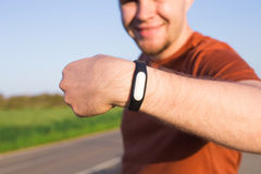 Activity tracker on a man`s wrist. On the street royalty free stock image