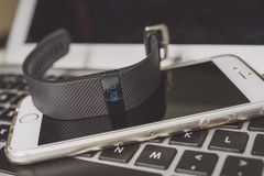 Activity Tracker. Placed on laptop keyboard and smartphone royalty free stock photo
