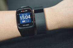 Activity tracker and sport watch on girl hand Royalty Free Stock Images