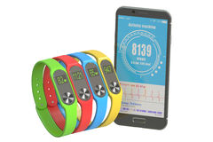 Activity trackers or fitness bracelets with smartphone  Royalty Free Stock Images