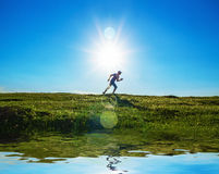 Activity - vitality man running on field. Grass. Healthy lifestyle Stock Image