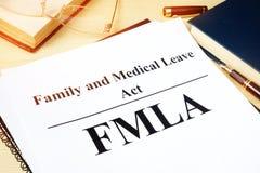 Acto de familia de FMLA y médica de licencia imágenes de archivo libres de regalías