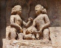 Acto erótico representado en escultura tallada hermosa Fotos de archivo