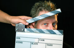 Actor. Clapper board in a front of actor ready for filming stock images