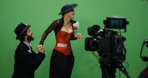 Actor and actress performing a scene. Slow motion shot of a cameraman recording an actor and an actress performing a romantic scene stock photo