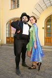 Actor animator Dmitry Giljov and beautiful young girl animator in surreal costumes in the Palace of Pavlovsk Palace Park. Open presentation in the courtyard and Stock Photos