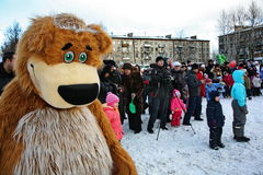 Actor animator of the house of culture of the city metallostroy in the costume of the jolly bear entertains children and adults Stock Images