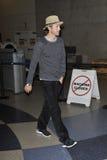 Actor Ashton Kutchner is seen at LAX airport. LOS ANGELES - FEBRUARY 15th: Actor Ashton Kutchner is seen at LAX airport .February 17th 2010 in Los Angeles Stock Photo