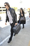 Actor Ashton Kutchner with wife Demi Moore at LAX. LOS ANGELES-APRIL 15: Actor Ashton Kutchner with wife Demi Moore at LAX airport. April 15 in Los Angeles Royalty Free Stock Photos