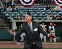 Actor Bill Murray catches the first pitch. Actor Bill Murray plays to the fans after he catches the first pitch at the 2016 Charleston RiverDogs home opener royalty free stock photos