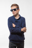 Actor brunette teenager hipster boy in sunglasses. On a white background stock photos