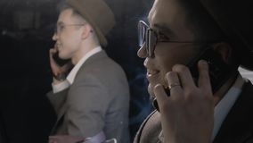 Actor calls during the break. A young man in a hat talking on the phone on the background of a mirror in the dressing room. Actor calls during the break stock video