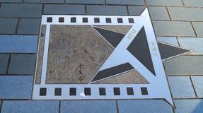 Actor conmemorativo Jet Li de la estrella en la avenida de estrellas en Hong Kong foto de archivo