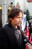 Actor David Duchovny. Is interviewed on the red carpet at the U.S. premiere of The X-Files: I Want to Believe at Mann Grauman's Chinese Theater in Los Angeles Stock Photography