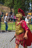 Actor depicting a Roman legionary for tourists near the Colosseu Royalty Free Stock Photo