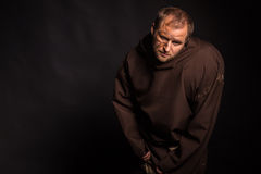 The actor in the guise of a beggar on a dark background Stock Photo