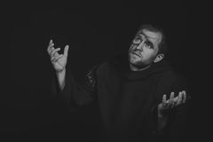 The actor in the guise of a beggar on a dark background Stock Photography