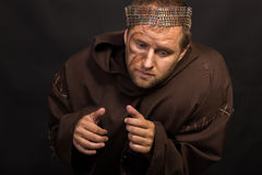 The actor in the guise of a beggar on a dark background Royalty Free Stock Photos