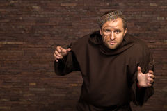 The actor in the guise of a beggar on a dark background Royalty Free Stock Photo