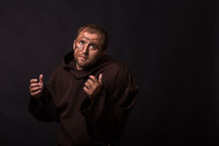 The actor in the guise of a beggar on a dark background. Professional theater costume and a nice suit. Photo for theater magazines, posters and websites Stock Images