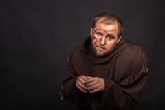 The actor in the guise of a beggar on a dark background Royalty Free Stock Photography