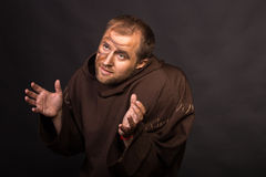 The actor in the guise of a beggar on a dark background Royalty Free Stock Image