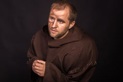 The actor in the guise of a beggar on a dark background Stock Images