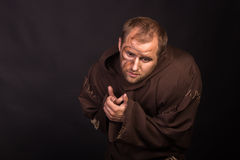 The actor in the guise of a beggar on a dark background Royalty Free Stock Images