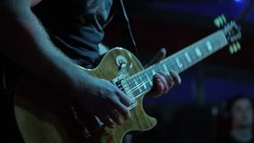 Actor guitarist playing the guitar. Musician plays a musical instrument on stage solo. stock footage