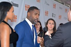 Actor Idris Elba at toronto international film festival. Actor Idris Elba and guest attend the premiere of `The Mountain Between Us` during the 2017 Toronto Royalty Free Stock Images