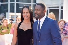 Idris Elba and Sabrina Dhowre at toronto international film festival. Actor Idris Elba and guest attend the premiere of `The Mountain Between Us` during the 2017 stock image