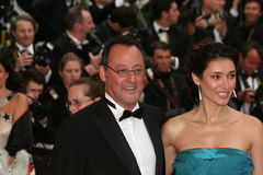 Actor Jean Reno. CANNES - MAY 25:Actor Jean Reno (R) and wife actress Zofia Borucka arrives at the Palme d'Or Closing Ceremony at the Palais des Festivals during Royalty Free Stock Images