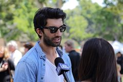 Actor Justin Baldoni Speaking with a Reporter Royalty Free Stock Photo