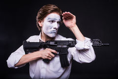 Actor in makeup mime with weapon Royalty Free Stock Image